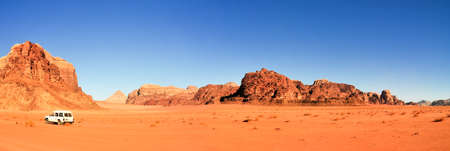 Wadi Rum also known as The Valley of the Moon. It is a valley cut into the sandstone and granite rock in southern Jordan 60 km to the east of Aqaba; it is the largest wadi in Jordan. photo