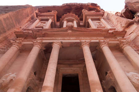 khazneh: Al Khazneh in Petra, Jordan. Al Khazneh was carved out of a sandstone rock face. It has classical Greek-influenced architecture. It is known as the Treasury. Stock Photo