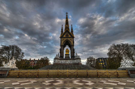 The London landmark in Hyde Park contrasting the neo-gothic monument against a threatening sky.   The memorial was built by Queen Victoria in remembrance of her husband, Prince Albert.