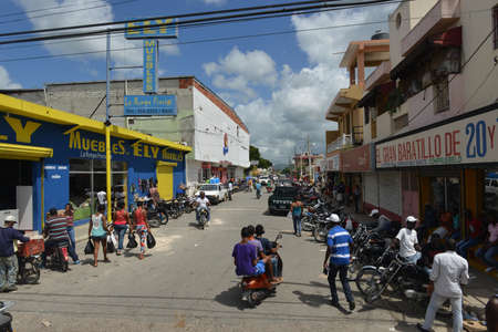 HIGÜEY, DOMINICAN REPUBLIC - AUGUST 31, 2014: Busy city street in the town of Higuey, Dominican Republic.