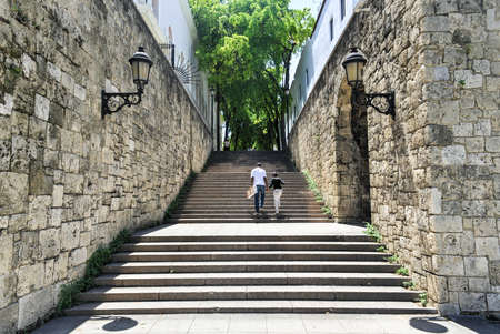 santo domingo: SANTO DOMINGO, DOMINICAN REPUBLIC - SEPTEMBER 2, 2014: Father and daughter walking the steps of El Conde Street in Santo Domingo, Dominican Republic