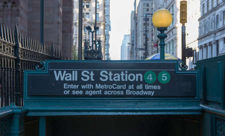 subway entrance: NEW YORK, NEW YORK - SEPTEMBER 27, 2014: Subway entrance in Lower Manhattan at Wall Street, New York