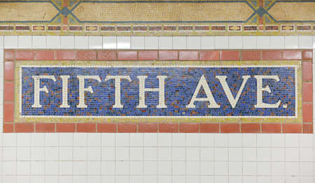 NEW YORK, NEW YORK - OCTOBER 27, 2014: Classic mosaic tile of the Fifth Avenue Subway Station, New York.