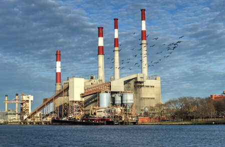 power: NEW YORK, USA - JANUARY 19, 2013: Ravenswood Generating Station in the morning in New York. The power plant uses natural gas, fuel oil and kerosene to power its boilers.