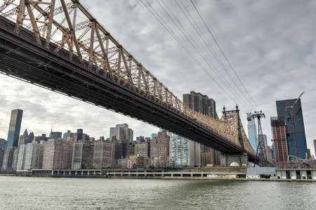 ed: Queensboro Bridge from Roosevelt Island connecting Manhattan to Queens, New York City. Stock Photo