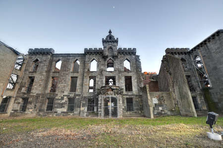 smallpox: Renwick Smallpox Hospital, an abandoned hospital located in an otherwise undeveloped area at the southern tip of the Roosevelt Island in Manhattan, New York City. Stock Photo