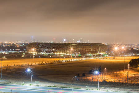 johannesburg: JOHANNESBURG, SOUTH AFRICA - SEPTEMBER 5, 2012: FNB Stadium, also known as Soccer City, is a stadium located in Nasrec, the Soweto area of Johannesburg, South Africa.