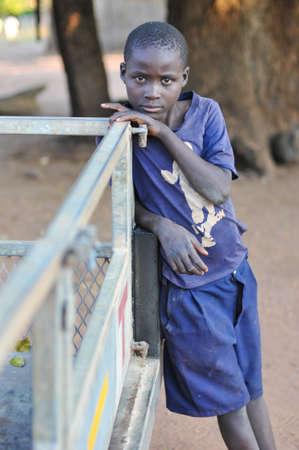 zambia: MIKUNI VILLAGE, ZAMBIA - APRIL 22, 2012: Boy from Mikuni Village, Zambia outside of Livingstone, Southern Zambia.