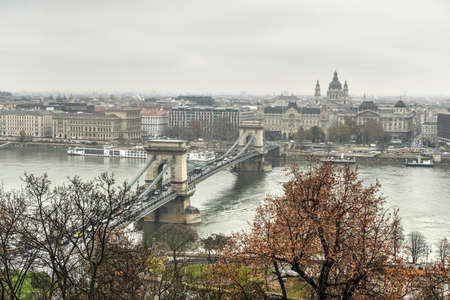 szechenyi: The Szechenyi Chain Bridge, a decorative suspension bridge that spans the River Danube of Budapest, the capital of Hungary as seen on a cloudy day.