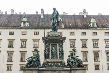 franz: VIENNA, AUSTRIA - NOVEMBER 30, 2014: Hofburg Palace courtyard with Emperor Franz I sculpture monument, Vienna, Austria. Editorial