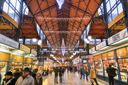 BUDAPEST, HUNGARY - DECEMBER 1, 2014: People shopping in the Great Market Hall in Budapest, Hungary. Great Market Hall is the largest indoor market in Budapest and was built in 1896.