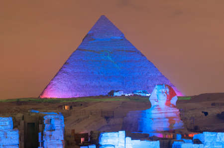 CAIRO, EGYPT - JANUARY 1, 2009: Giza pyramid and Sphinx light up for magical sound and light show.