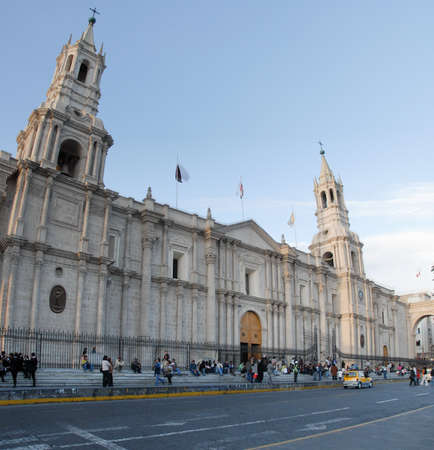 AREQUIPA, PERU - August 11, 2006: Main square of Arequipa with church. Arequipa's Plaza de Armas is one of the most beautiful in Peru.