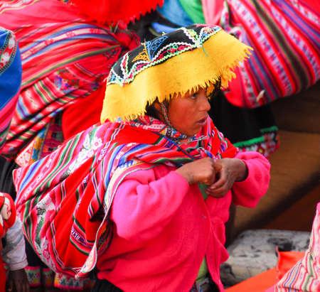 riparian: LAKE TITICACA, PERU - AUGUST 15, 2006: Traditionally dressed Peruvian woman around Lake Titicaca in Peru, South America.
