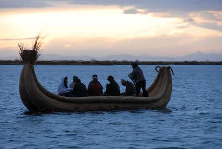 riparian: LAKE TITICACA, PERU - AUGUST 15, 2006: Riders in a reed boat around Lake Titicaca in Peru, South America.