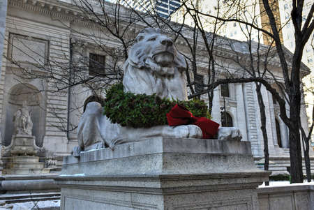Stone lion at the entrance to the New York Public Library Main Branch in Midtown, Manhattan, New York. photo