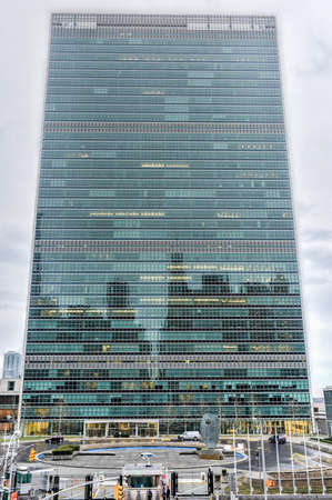 united nations: NEW YORK, NEW YORK - JANUARY 4, 2015: United Nations headquarters in New York against the traffic.