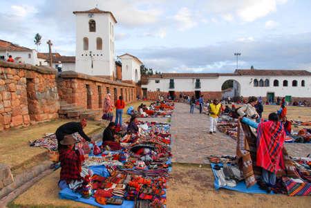 CHINCHERO, PERU - AUGUST 20, 2006: Inca Outdoor Craft Market and Church in Chichero, Peru. Editorial