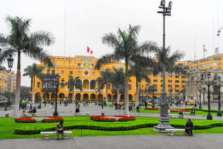 LIMA, PERU - AUGUST 21, 2006: Main Square - Plaza de Armas (Plaza Mayor) of Lima, Peru with the Municipal Building in the background.
