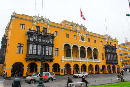 plaza of arms: LIMA, PERU - AUGUST 21, 2006: Municipalidad de lima - Municipal Building City Hall in the Plaza Mayor (Plaza de Armas) in Lima, Peru