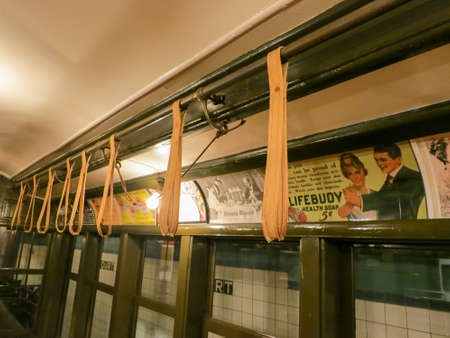 transit: BROOKLYN, NEW YORK - SEPTEMBER 15, 2012: New York Transit Museum with vintage train and advertisements. Editorial