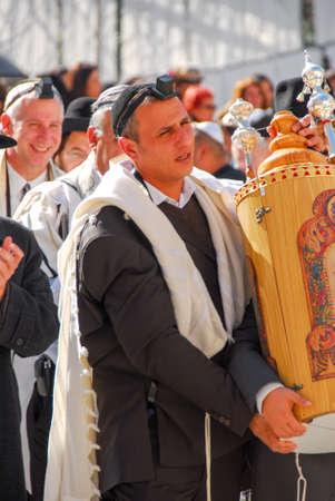 tora: JERUSALEM - JANUARY 18, 2007: Bar Mitzvah ritual at the Wailing (Western) wall in Jerusalem, Israel.