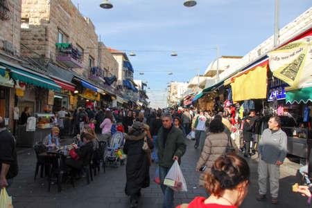 merchant: JERUSALEM, ISRAEL - JANUARY 19, 2007: People shopping at the Mahane Yehuda - famous market in Jerusalem. Editorial