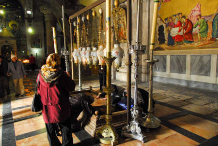 jewish home: JERUSALEM, ISRAEL - JANUARY 20, 2007: Interior of the Holy Sepulchre Church with people at prayer.