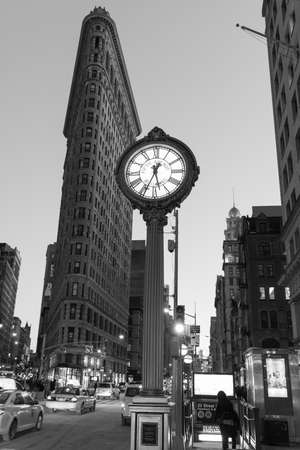 broadway tower: NEW YORK, NEW YORK - JANUARY 31, 2015: Flatiron Buliding and Fifth Avenue Clock. Completed in 1902, it is considered to be one of the first skyscrapers ever built.