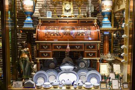 antique dishes: NEW YORK, NEW YORK - DECEMBER 25, 2014: Antique Store Window at night in New York. Editorial