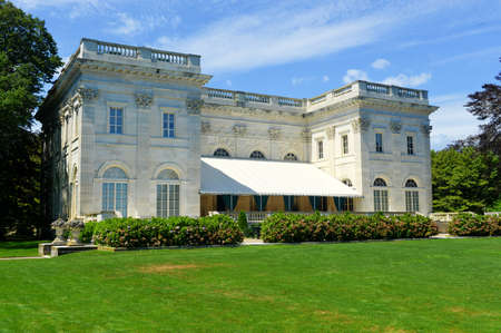 NEWPORT, RHODE ISLAND - AUGUST 4, 2013: The Marble House in Newport, Rhode Island. It is a Gilded Age mansion and its temple-front portico is like that of the White House.