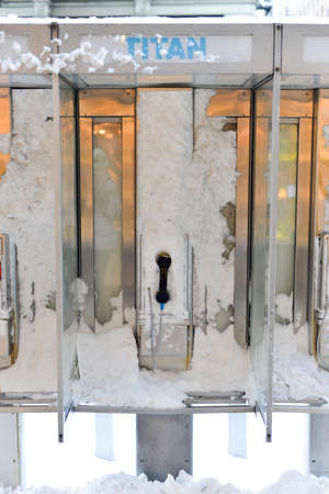 payphone: NEW YORK, NEW YORK - FEBRUARY 9, 2013: New York Payphone covered in snow following a blizzard.