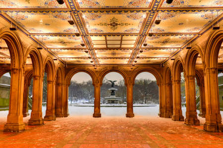 The illuminated Minton Tile Ceiling at the Bethesda Terrace at night in the winter in Central Park, New York.
