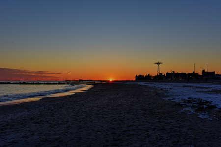 coney: Sunset on Coney Island Beach in the winter.