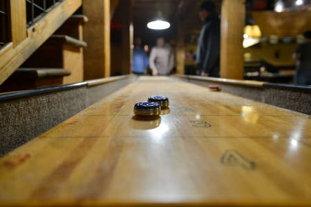 table surface: AUSTIN, TEXAS - MARCH 6, 2014: Table Shuffleboard at Buffalo Billiards in Austin, Texas. Editorial