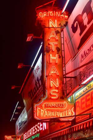 coney: BROOKLYN, NEW YORK - MARCH 21, 2015: Original Nathans Frankfurters restaurant in Coney Island, Brooklyn, New York at night.