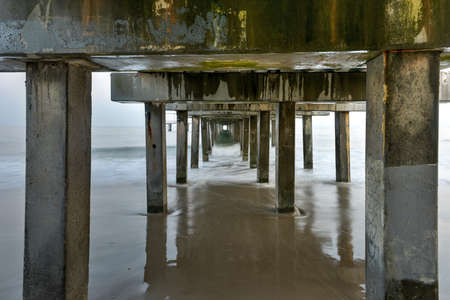 coney: Under the pier at the beach at Coney Island, Brooklyn, New York. Stock Photo