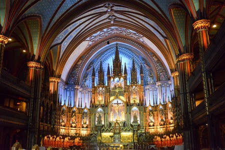 gothic revival: MONTREAL, CANADA - FEBRUARY 23, 2013: Interior of Notre-Dame basilica cathedral and its altar in Montreal, Canada. The churchs Gothic Revival architecture is among the most dramatic in the world.