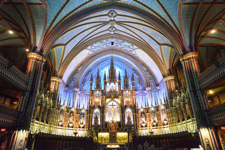 MONTREAL, CANADA - FEBRUARY 23, 2013: Interior of Notre-Dame basilica cathedral and its altar in Montreal, Canada. The churchs Gothic Revival architecture is among the most dramatic in the world.