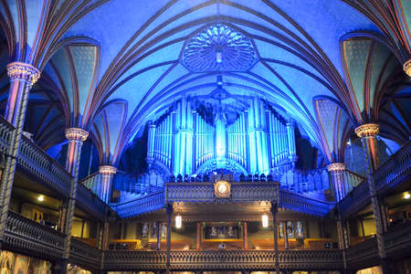 gothic revival: MONTREAL, CANADA - FEBRUARY 23, 2013: Interior of Notre-Dame basilica cathedral and its organ in Montreal, Canada. The churchs Gothic Revival architecture is among the most dramatic in the world. Editorial