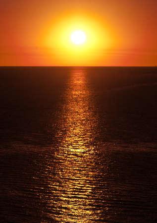 investment real state: Puesta de sol sobre el oc�ano desde la Colonia de Sacramento, en Uruguay.