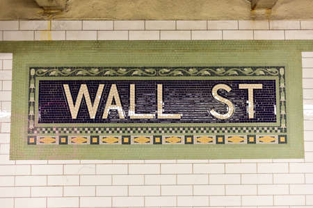 nyse: Wall street subway sign tile pattern in New York City Manhattan station. Editorial