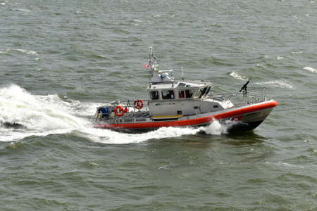 coast guard: US Coast Guard Ship in the East River defending a Staten Island Ferry boat in New York. Editorial