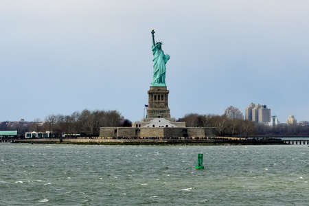 View of the Statue of Liberty over the water. Stock Photo