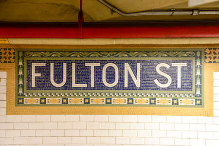 apri: New York, NY - Apri 17, 2015: Fulton Street Subway station mosaic tile in lower Manhattan. Editorial