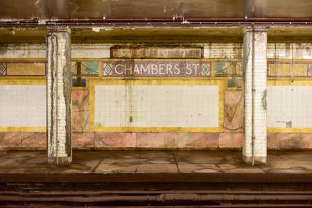 terra cotta: New York, USA - May 30, 2015: Chambers Street Subway Station in Manhattan. Intricate tiles with symbols of the Brooklyn Bridge in terra cotta.