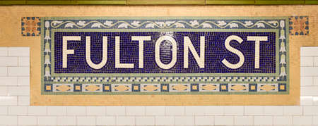 apri: New York, NY - Apri 17, 2015: Fulton Street Subway station mosaic tile in lower Manhattan. Stock Photo