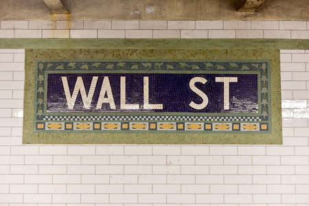 nyse: Wall street subway sign tile pattern in New York City Manhattan station. Stock Photo