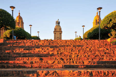 Union Buildings, Pretoria, South Africa at sunset. Adjacent World War I monument.