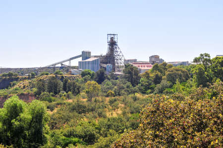 Cullinan Mine seen in the distance, famous for The Cullinan diamond the largest rough gem-quality diamond ever found, at 3106.75 carats. The mine shaft stands out distinctly.